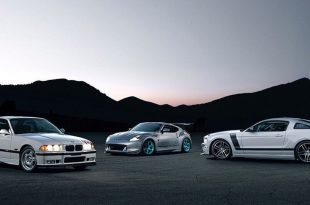 A white BMW M3, a white Ford Mustang and a silver Nissan 350Z